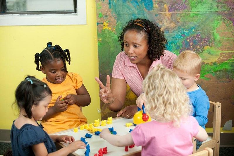 Woman teaching young children