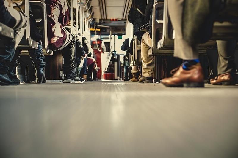People's feet on a train